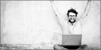 Happy man watching an Itil 4 online training on his laptop
